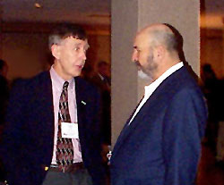 Louisiana Governor Mike Foster and U.S. Geological Survey Director Charles Groat discuss the magnitude of the problem at the Coastal Marsh Dieback conference held January 11-12, 2001 in Baton Rouge, Louisiana.